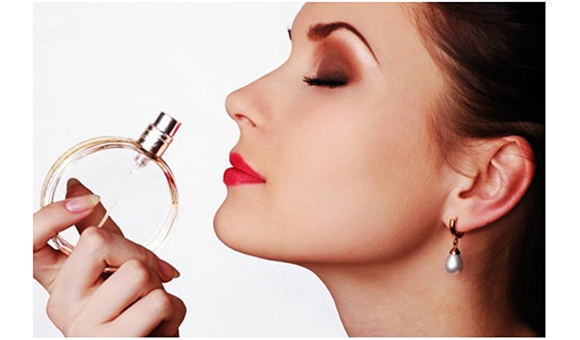 image-of-woman-smelling-perfume-1