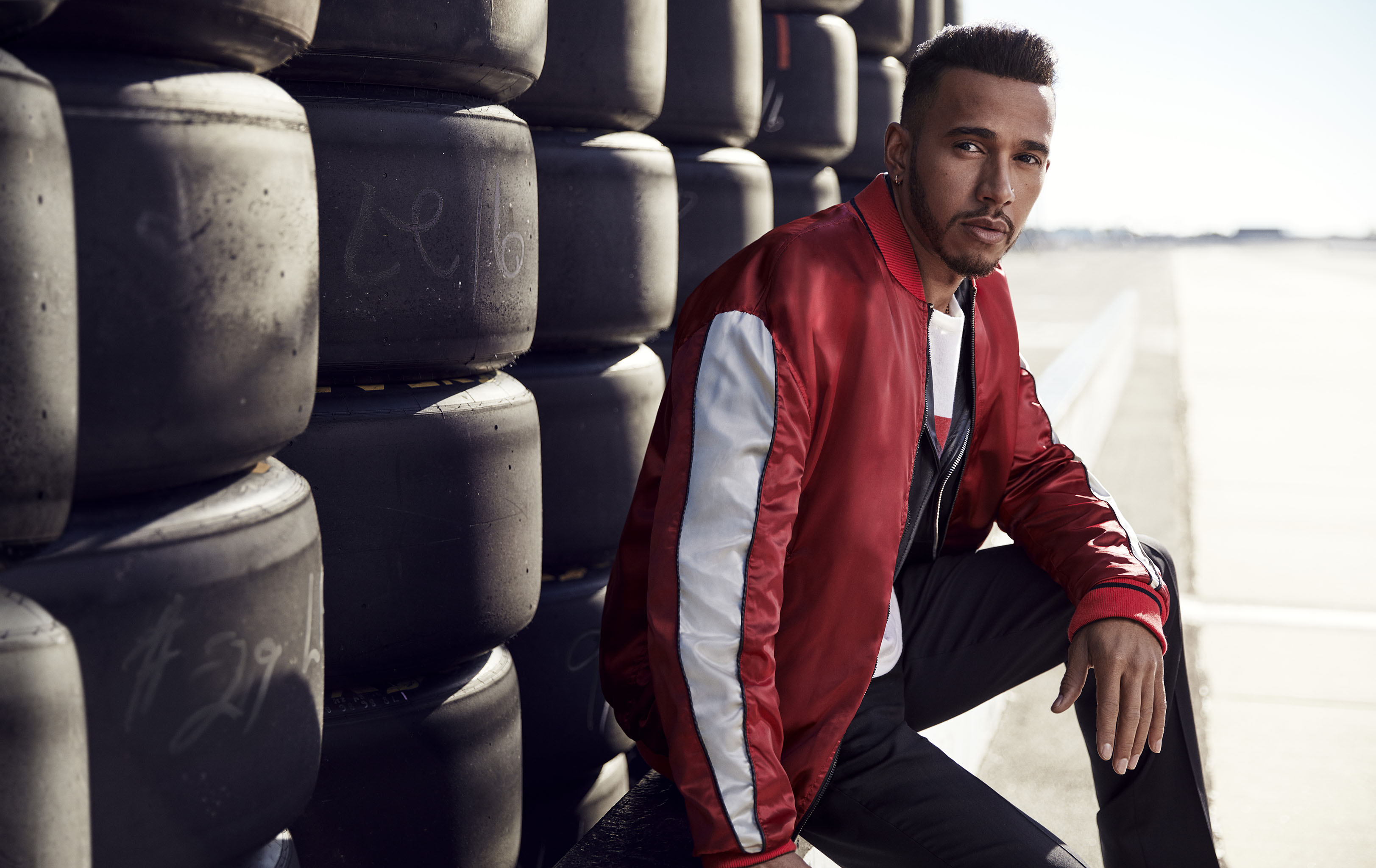 4429896f6 The Tommy X Lewis Hamilton Spring 2018 campaign image courtesy of wwd.com